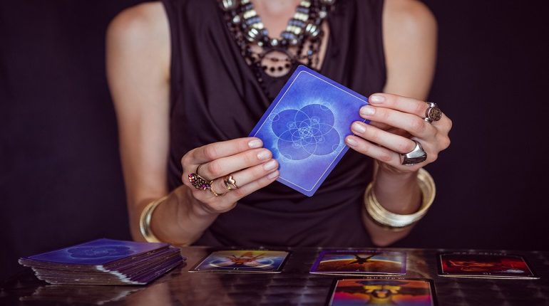 Meaning of tarot cards falling out of deck when shuffling.